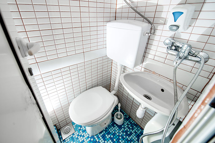 """The ensuite shower rooms are like a """"wet-room"""" with toilet, basin and shower hose"""