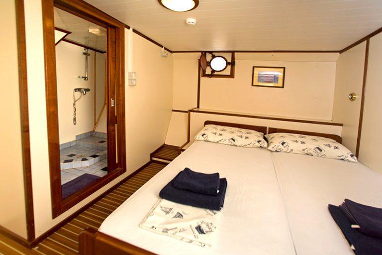 Below deck double cabin with ensuite shower-room.